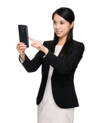 Asian businesswoman using the cellphone for takinf photo