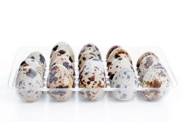 Quail eggs in plastic box