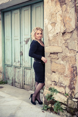 Pretty Blond Lady in the old town (mediterrainean architecture)