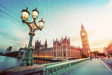 Fotomurales - Big Ben, London the UK at sunset. Retro street lamp light on Westminster Bridge. Vintage