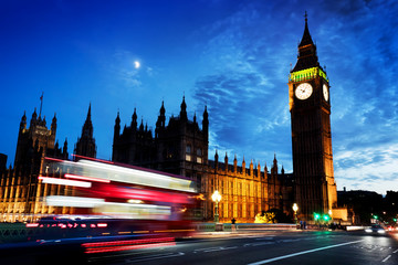 Wall Mural - Red bus, Big Ben and Westminster Palace in London, the UK. at night. Moon shining