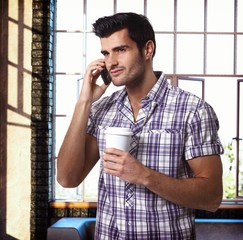 Handsome man talking on mobilephone