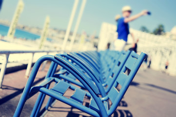 characteristic blue chairs at the Promenade des Anglais in Nice,