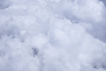 view from the window when airplane flying in the cloud