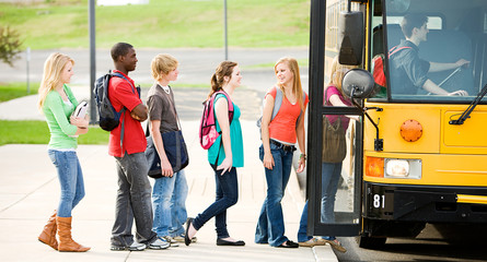 School Bus: Line of Students Boarding Bus