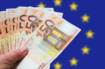 Fan of euro bills with EU logo