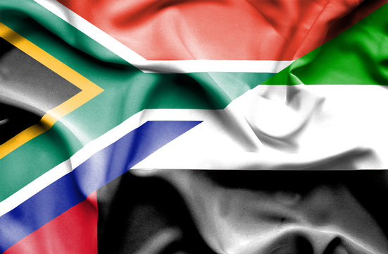 Waving flag of United Arab Emirates and South Africa