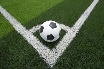 soccer ball or football on soccer field