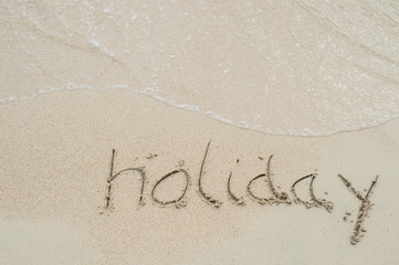 holiday, word drawn on the beach