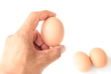 man holding egg with her hand isolated on white background