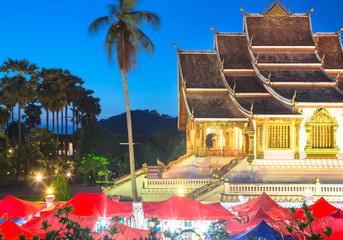 Famous night market and the Haw Pha Bang temple in Luang Praban