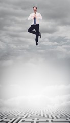 Composite image of smiling businessman standing in tree pose
