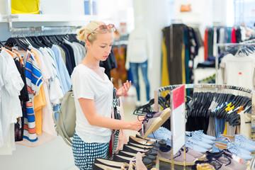Beautiful woman shopping in clothing store.