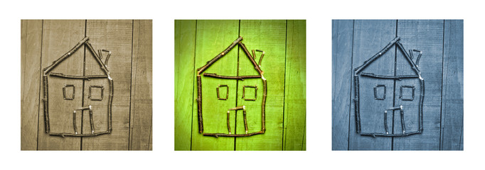 miniature of house made from sticks on wooden background. Triptych in brown, green and blue.