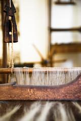 Closeup image of an old weaving Loom