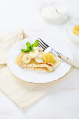 Delicious crepes with banana and honeycomb