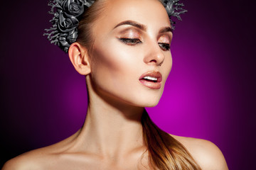 Voluptuous model with beautiful makeup on purple background