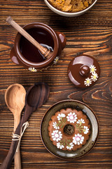 Gingerbread cookie decoration, honey pot, bowl with cornflakes