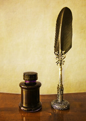 vintage pen with holder, feather and ink pot