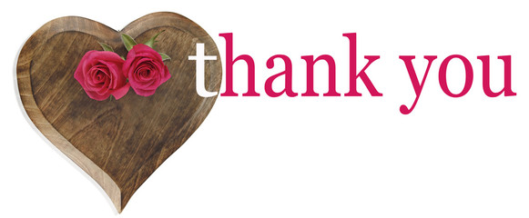 Saying Thank You - heart shaped wooden plaque with two pink roses laid on top and the words 'thank you' on right hand side
