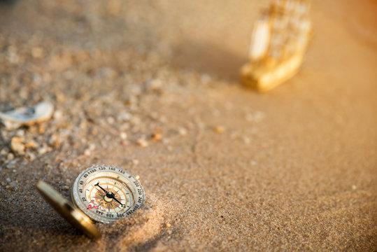 Retro compass on the beach, vintage style