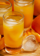 Freshly squeezed apricot juice with ice, selective focus