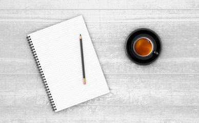 Notepad with cup of coffee on wooden table.
