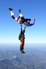 Skydiving photo. Maneuvers in free fall. Formation friends.