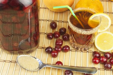 Glasses with cherries with rum. Preparing for summer refreshment cocktail. Cane rum and sugar. Sour pickled in rum.