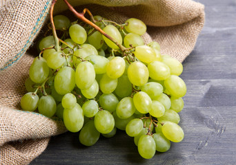 bunch green grapes on wooden background