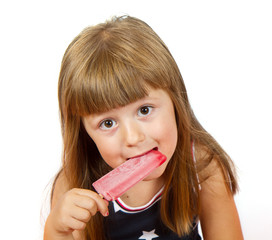 Little girl eating colorful ice lolly