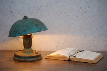 Lamp, glasses and open book
