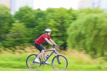 Cycling and Sport Concepts: Handsome Caucasian Rider Having a Bi