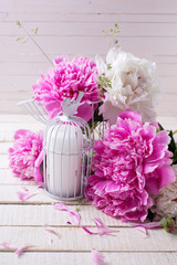 Background with fresh peonies flowers and decorative candle