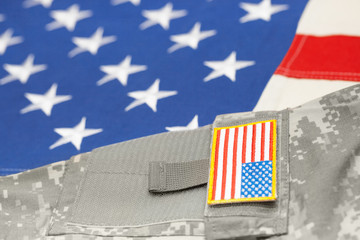 USA army uniform over American flag