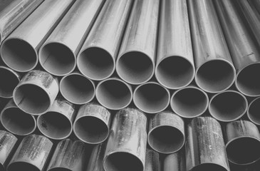 Close - up Stack of construction metal pipes .
