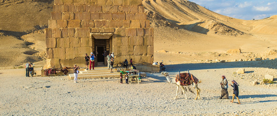 Tourists near the tomb in Palmyra, Syria