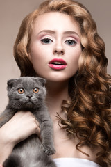 Beautiful young girl,  natural light makeup and curls with a cat
