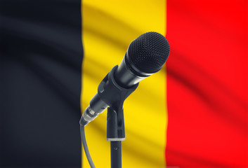Microphone on stand with national flag on background - Belgium