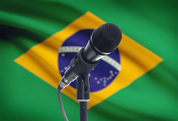 Microphone on stand with national flag on background - Brazil