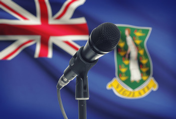 Microphone on stand with national flag on background - British Virgin Islands