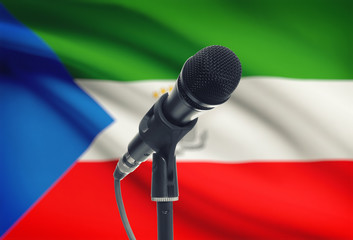 Microphone on stand with national flag on background - Equatorial Guinea