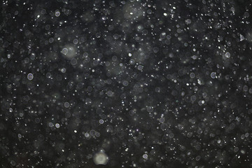 texture of white rain drops on a black background for a filter on the photo
