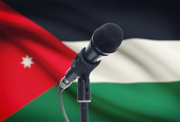 Microphone on stand with national flag on background - Jordan