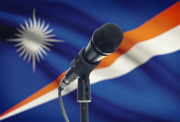 Microphone on stand with national flag on background - Marshall Islands