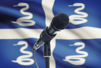 Microphone on stand with national flag on background - Martinique