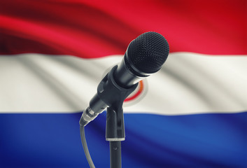 Microphone on stand with national flag on background - Paraguay