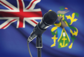 Microphone on stand with national flag on background - Pitcairn Island
