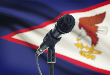 Microphone on stand with national flag on background - American Samoa