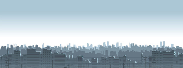 Panoramic view of gray-blue city silhouette.
